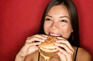 woman-eating-fast-food-burger