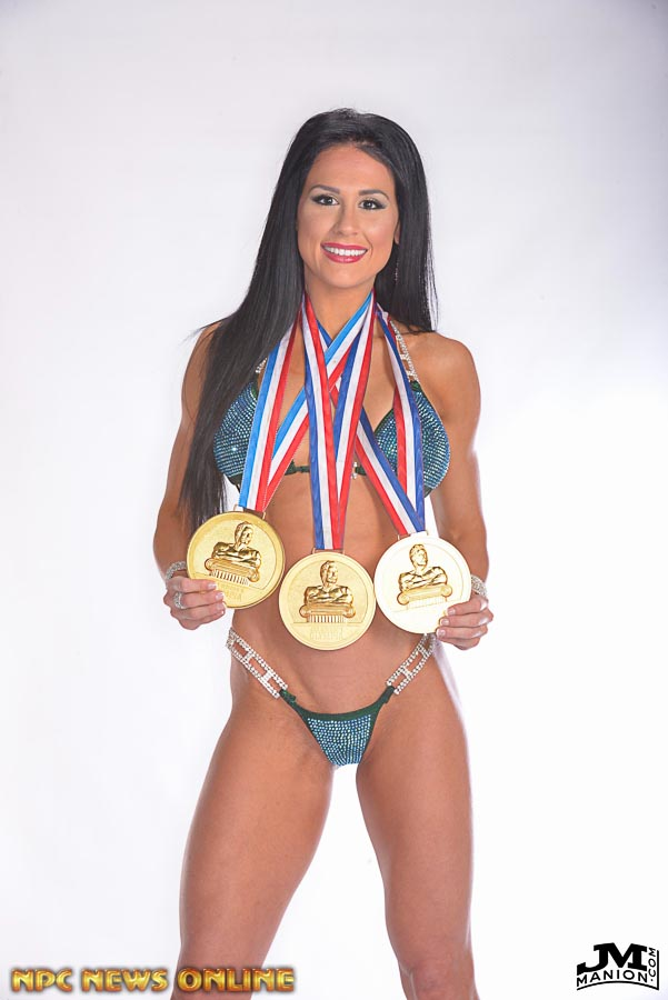 Ashley with her three Olympia medals