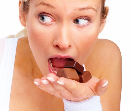 young-woman-eating-chocolates