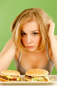young-woman-feels-bad-about-eating-junk-food-smaller